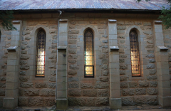 Clairvaux west facade stain glass windows in morning light (15)